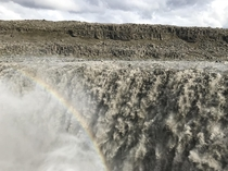 Dettifoss Iceland the most powerful waterfall in Europe the mist causing an almost permanent hazy rainbow