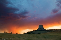 Devils Tower sunset storm with a lightning strike