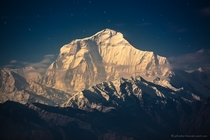 Dhaulagiri the Earths th highest mountain in the light of the rising moon Nepal