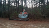 Discarded Amoco station sign found in woods behind functioning BP station St Pauls NC
