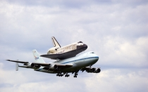 Discovery being carried from Kennedy Space Center Florida to Washington DC by a Shuttle Carrier Aircraft By its last mission Discovery had flown  million miles  million km in  missions completed  orbits and spent  days in orbit in over  years