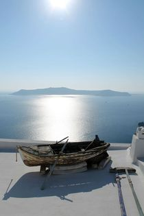 Distant Volcano with an abandoned rowing boat Santorini Greece