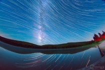 Distorted Star Trails and Milky Way composite I did over Spruce Knob Lake WV with a fisheye