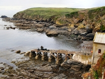 Disused lifeboat slipway Polpeor Cove Cornwall England by David Dixon
