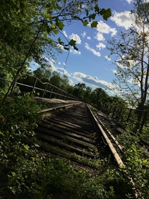 disusedabandoned train trestle I hike to often I thought this picture came out pretty nice the lighting was definitely in my favor