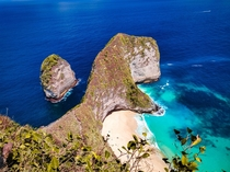 Doesnt the cliff looks like a giant thirsty dinosaur drinking water  Picture taken from Nusa penida island indonesia
