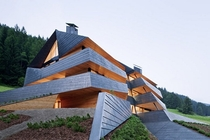 Dolomitenblick House - An Angular Copper-Clad Apartment Building in Italy by Plasma Studio