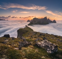 Dragons ridge - the mountains of Senja Norway piercing through the clouds  by Daniel Kordan