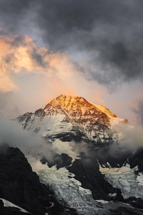 Dramatic clouds and a fiery sunset in the Bernese Alps