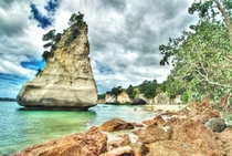 Dramatic clouds over Cathedral Cove New Zealand