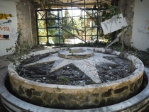 Dried fountain inside an abandoned resort in Mexico  Album in comments