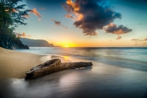 Driftwood on beach at sunset on north shore of Kauai