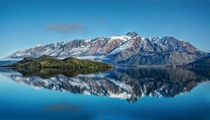 Driving to Glenorchy New Zealand and there was a good reflection of Pig Island in Lake Wakatipu