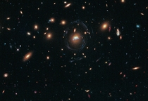 Droplets of star formation and two merging galaxies in SDSS J