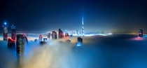 Dubai covered in fog by night