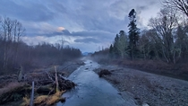Dungeness River with the Olympic Mountains far in the distance on a rainy winter day - Sequim WA