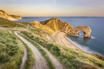Durdle Door sunset at Jurassic Coast England by Sophia Spurgin
