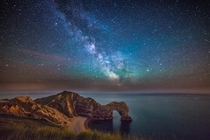 Durdle Door under the stars Dorset UK by Stephen Banks