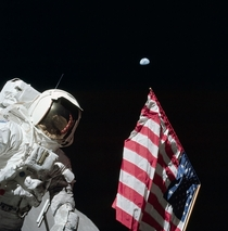 During the first EVA of Apollo  Eugene Cernan photographed Harrison Schmitt with the American flag and the Earth km away in the background