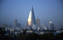 Dusk settles over Pyongyang North Korea as the -story Ryugyong Hotel towers over residential apartments Under construction for nearly  years later it has become a major Pyongyang landmark but has never been used as a hotel as it was intended Wong Maye-E