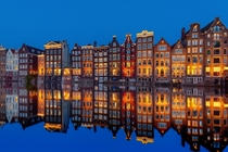 Dutch Colonial canal townhouses in Amsterdam Netherlands