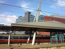 Dutch railway station Utrecht Overvecht with a train passing by