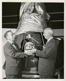 Earl Dorfman managing director of the National Historical Wax Museum presenting a model of astronaut Alan Shepards head to Philip Hopkins the director of the National Air Museum Washington DC September