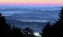 Early morning fog over the valleys near Bernbeuren southern Germany