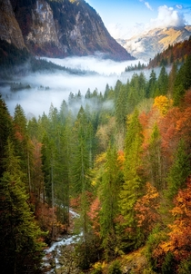 Early morning mists filling the Valle dAulps Haute Savoie France