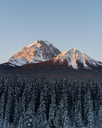 Early morning sunlight on some mountains as I was waiting for a train Banff National Park Alberta