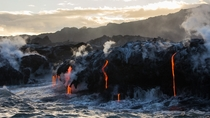 Earth Air Fire and Water Lava from Kilauea dripping into the sea the Big Island Hawaii