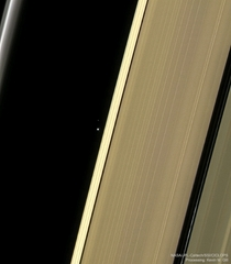 Earth and moon through the rings of Saturn as taken by Cassini probe