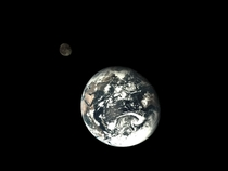 Earth with the moon in the background taken by Chinas Change -T