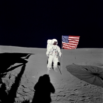 Edgar D Mitchell lunar module pilot for the Apollo  lunar landing mission stands by the US flag during the early moments of the first EVA of the mission He was photographed by Alan B Shepard Jr mission commander using a mm modified lunar surface Hasselbla