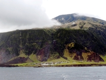 Edinburgh of the Seven Seas is the main settlement on the island of Tristan da Cunha an overseas territory of the UK in the South Atlantic Ocean It is regarded as the most remote permanent settlement on Earth being km from the nearest human settlement on
