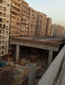 Egyptian Government building a highway in the middle of residential area as close at  in or  cm from some of the homes