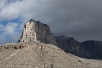 El Capitan emerging from clouds in crazy winds Guadalupe Mountains NP Texas