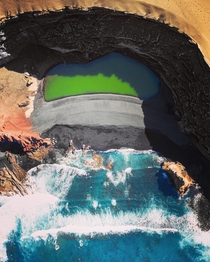 El Golfo  Formed in a crater of an old volcano where bright green algae grows under the water  OC