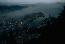 Embracing the fjord a dusk-dimmed Bergen laps against mountain walls Norway  x