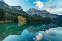 Emerald Lake Yoho National Park British Columbia Amid the conifer-clad slopes high peaks and fluffy clouds reflected in Emerald Lake is a meadow that seems out of place It is an avalanche slide path created in the winter of  Kirk Lougheed