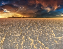 Emerging storm clouds over Salar de Uyuni the worlds largest salt flat  sq km sq mi Bolivia