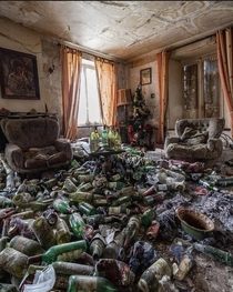 Empty bottles everywhere yet this living room seems parched of hope