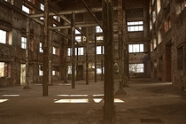 Empty factory building - no floors no windows just beams and walls - somewhere in Leipzig Germany