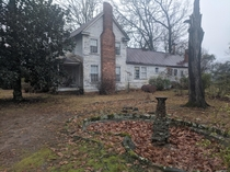 Empty fountain and abandoned colonial house