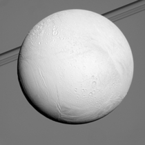 Enceladus in front of Saturns rings Cassini imaging
