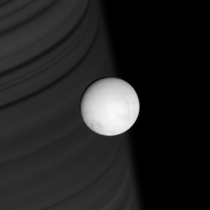 Enceladus with Saturn in the Backdrop