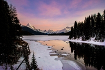Ended up at Maligne Lake in Jasper National Park Alberta Canada on my honeymoon We were the only ones around for miles during this sunset