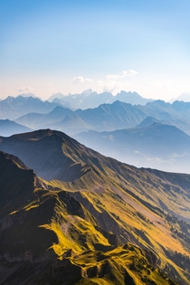 Endless mountain layers glowing in the morning light Bern Switzerland  by hansiphoto