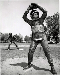 Engineers playing baseball in BF Goodrich Mark IV space suits at US Naval Air Material Center in Philadelphia Pennsylvania ca