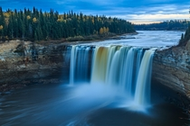 Enterprise Falls as the sun sets in the Northwest Territories Canada